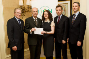 Dr Tim Counihan (2nd left), EAN national delegate, presenting an award at the Registrar's prize