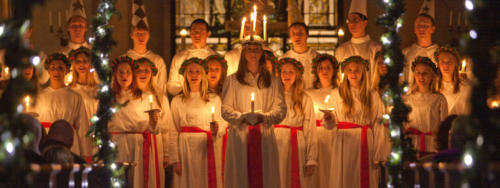 One of the biggest celebration around Christmas in Sweden is St. Lucia's Day on the 13th of December. St. Lucia was a young Christian girl who was killed for her faith in 304. She was said to have secretly brought food to the prosecuted Christians in Rome, who were hiding in the catacombs. She wore candles on her head to have both her hands free to carry things. Her name translates to 'light'. In the old Julian Calendar, December 13th also marks the winter solstice. The pagan festival of lights was turned into St. Lucia's day when Christianity was brought to Sweden.